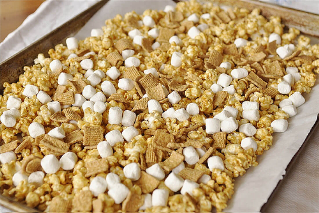 Take traditional Caramel Popcorn to the next level with this S'mores version! Step 1