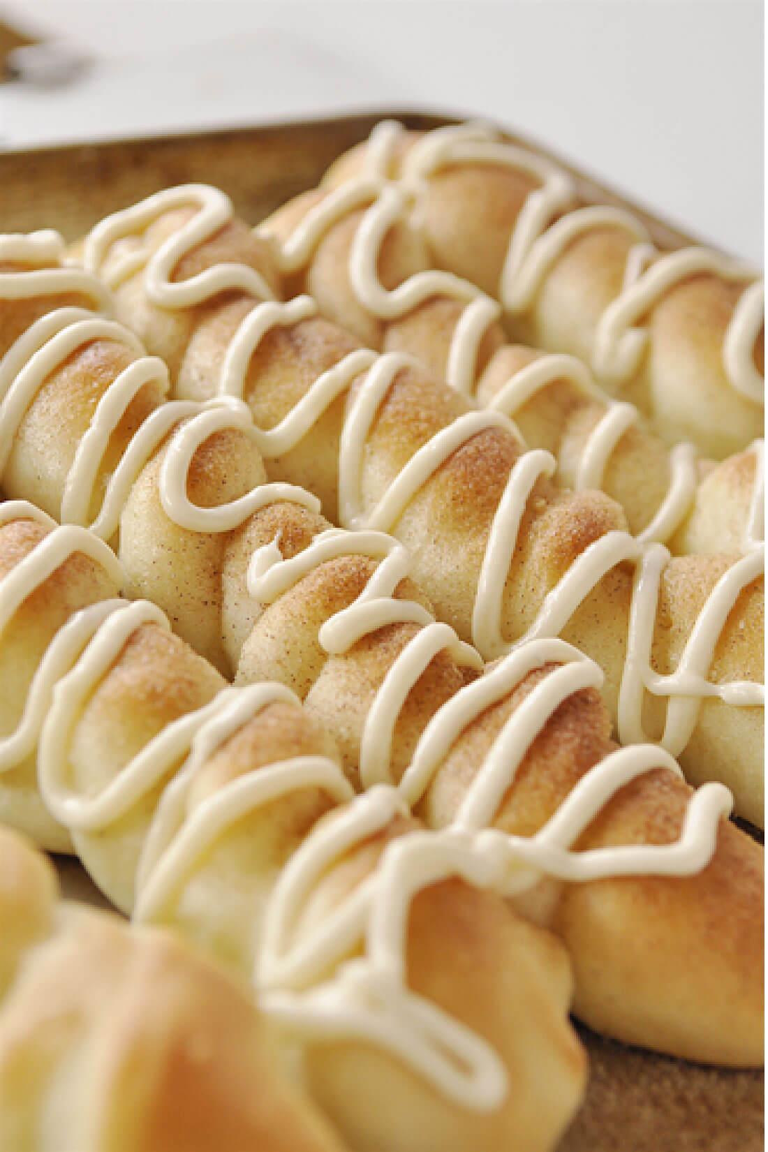 Cinnamon Sugar Breadsticks with Cream Cheese Frosting - the yummiest dessert to make.