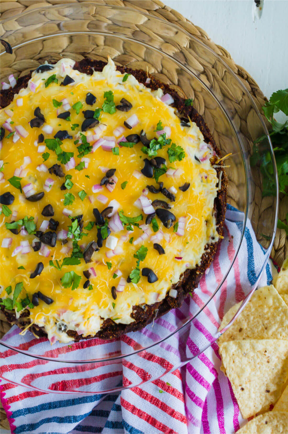 Layered Bean Dip - this bean dip recipe isn't your typical one. It has a little kick and a whole lot of flavor. www.thirtyhandmadedays.com
