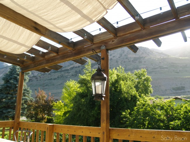 ... pergola shade and lights - Outdoor Space Makeover: Painted Floors & DIY Drop Cloth Shade