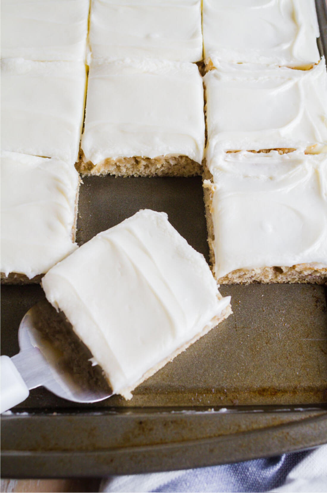 Frosted Banana Bars Recipe - use overripe bananas to make this recipe with cream cheese frosting. Serving a square.