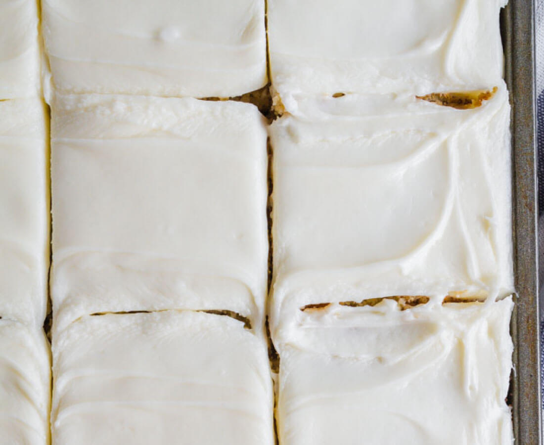 Frosted Banana Bars Recipe - use overripe bananas to make this recipe with cream cheese frosting. Yum!