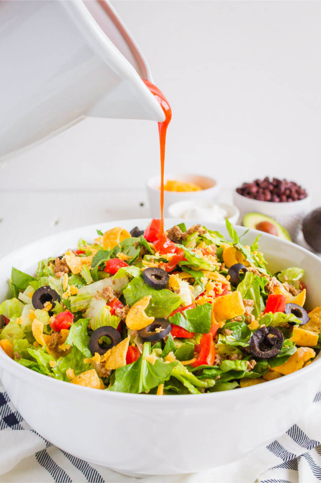 Mom's Taco Salad - make this easy dinner that your whole family will love. Pouring dressing