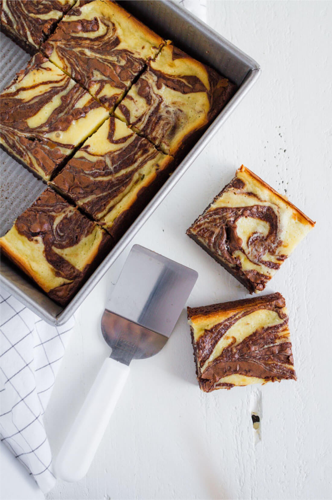 Cheesecake Brownies - they are delicious and simple and a fun take on regular brownies. Pan full of brownies.
