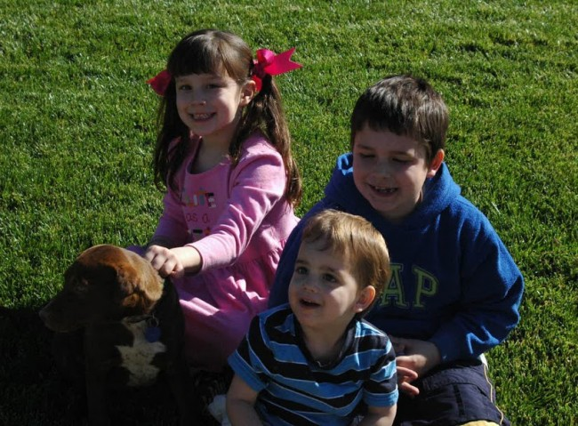 3 kids with our dog