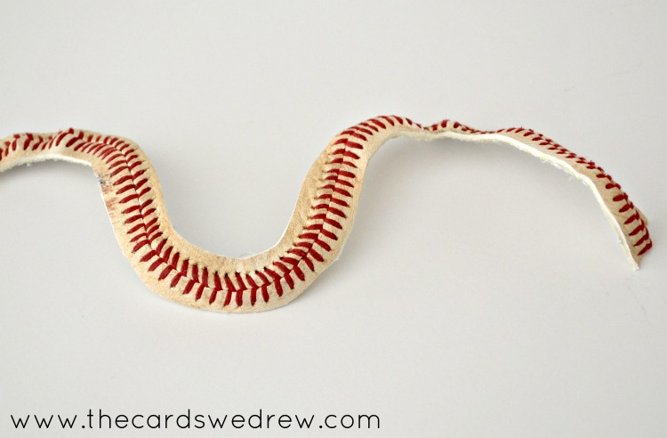 Cut off the stitching of the baseball