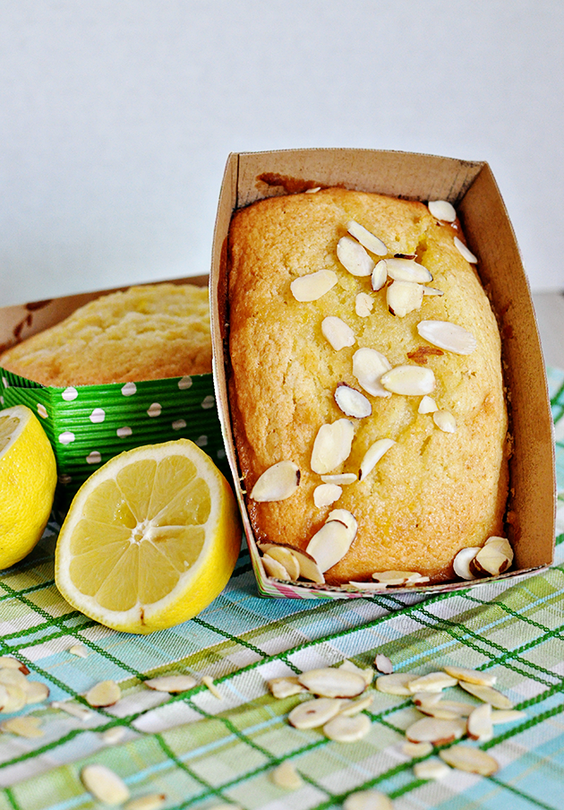 Glazed Lemon Bread with optional almond topping- amazing and simple, light and fluffy.  Yum!