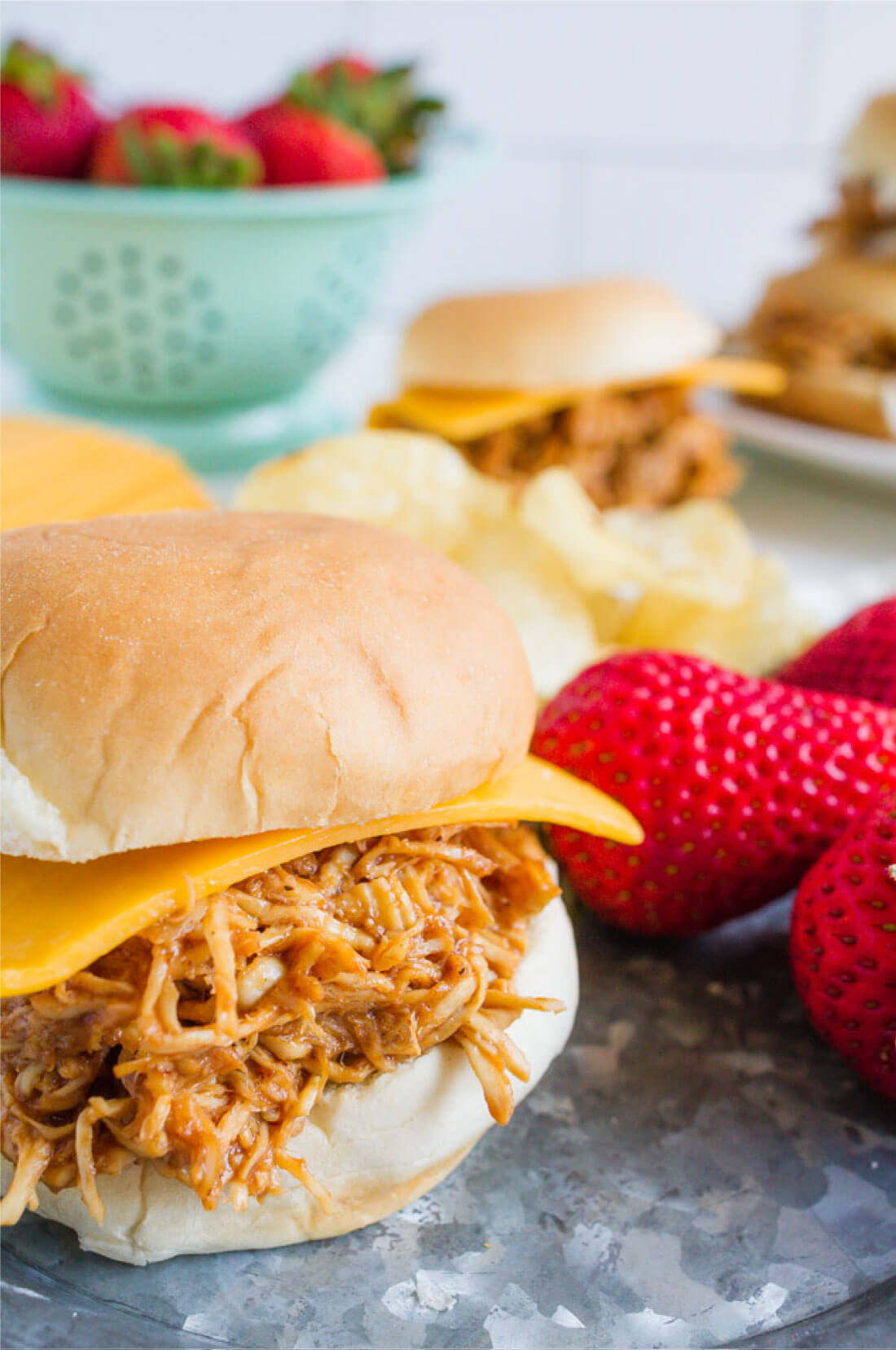 Crockpot Buffalo Chicken Sliders - make this in the slow cooker and your family will love it! via www.thirtyhandmadedays.com