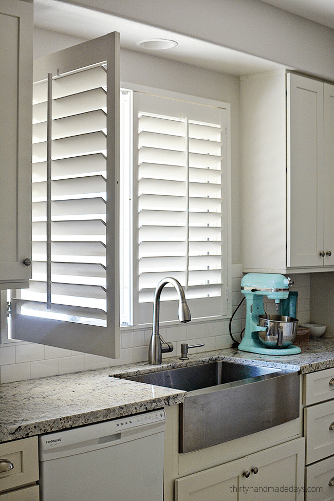 Kitchen with plantation shutters www.thirtyhandmadedays.com