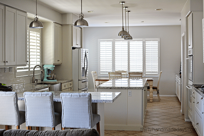 Kitchen with plantation shutters from www.thirtyhandmadedays.com