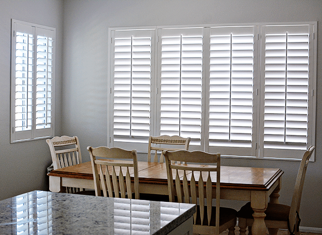 Plantantion Shutters in our kitchen www.thirtyhandmadedays.com