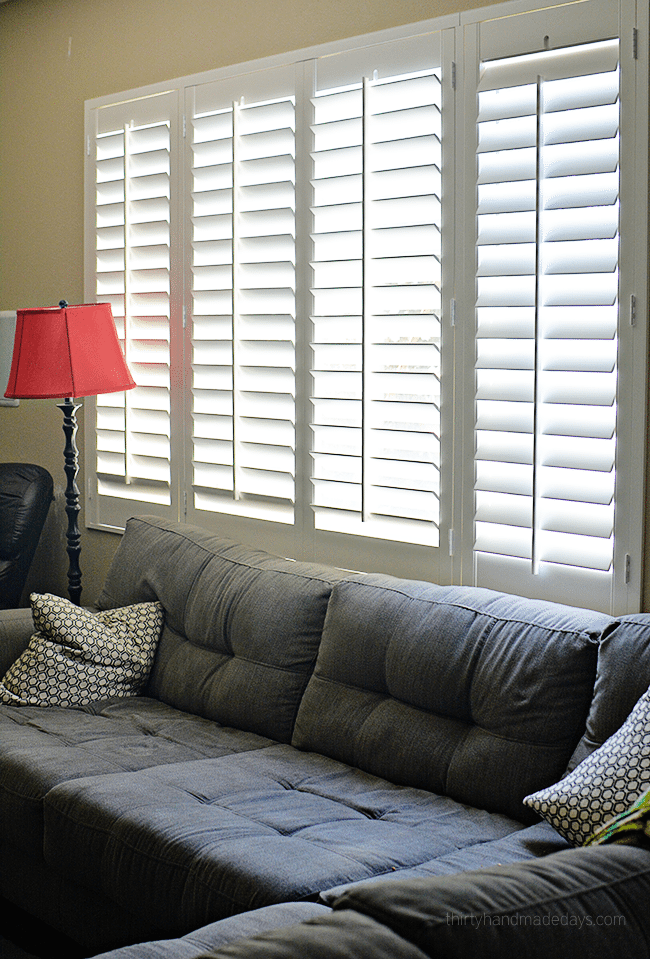 Family room with plantation shutters www.thirtyhandmadedays.com
