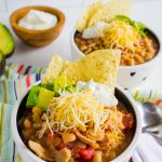 Slow Cooker White Bean Chicken Chili Recipe - a healthy recipe that your whole family will love. Shown with all of the toppings.