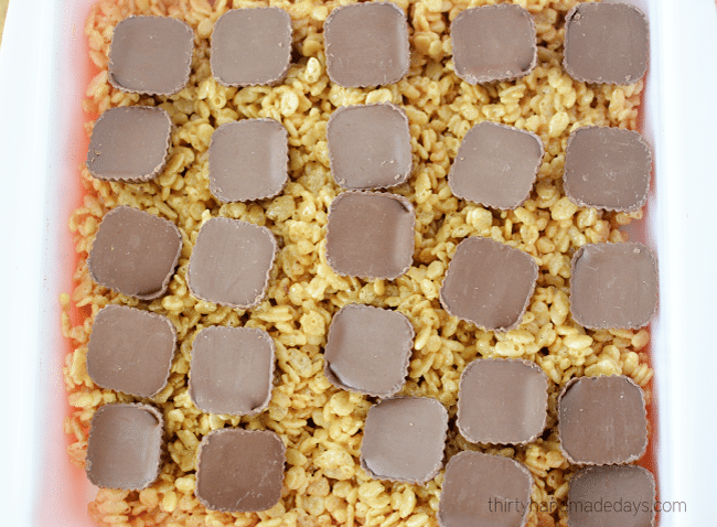 Layer Butterfinger Peanut Butter Cups on Rice Crispy Treats
