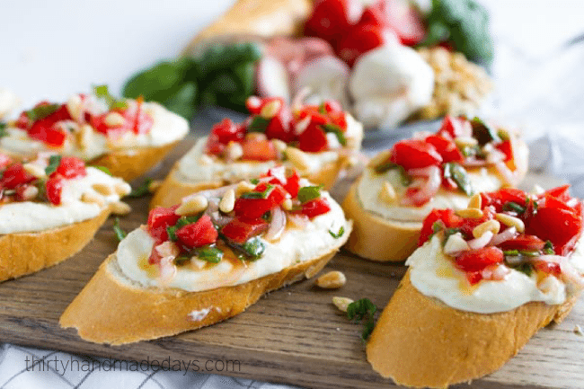Tomato Crostini with Whipped Feta - this is the best appetizer ever. So delicious! from www.thirtyhandmadedays.com