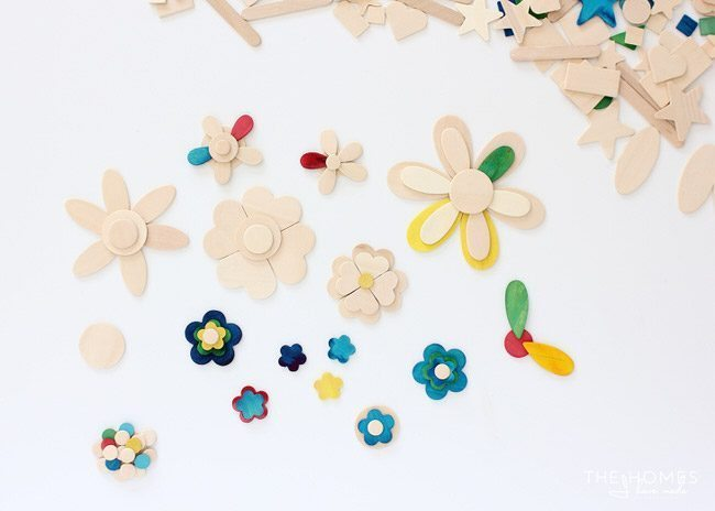 Use a variety of wooden shapes to create adorable flower cake toppers!