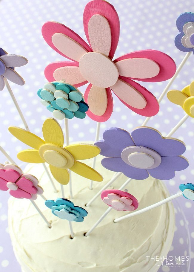 Glue and paint wooden shapes together to create a darling flower display...perfect for adorning a cake for any Springtime occasion!