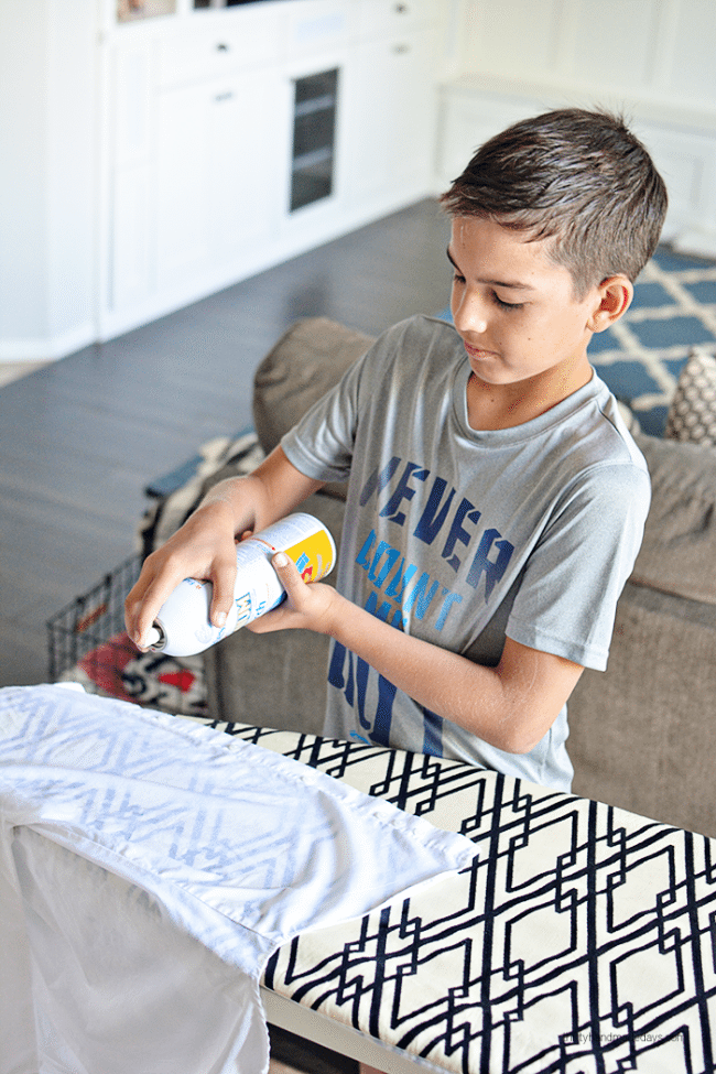 Teaching kids How to Iron - spraying Faultless Starch from www.thirtyhandmadedays.com