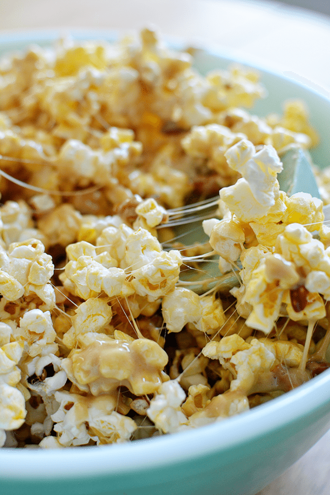 Salty and Sweet Caramel Popcorn Bars- how to make them, stirring the ingredients. A fun, delicious treat from www.thirtyhandmadedays.com