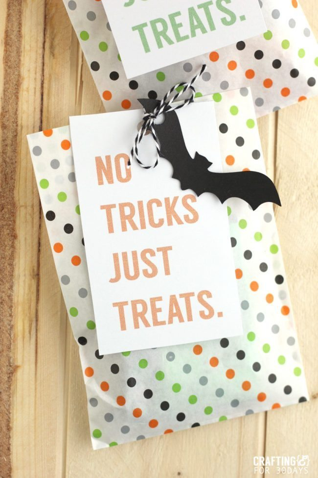 Brightly colored and cute Printable Halloween Treat Tag - you could fill these up with all kinds of goodies for the holiday!