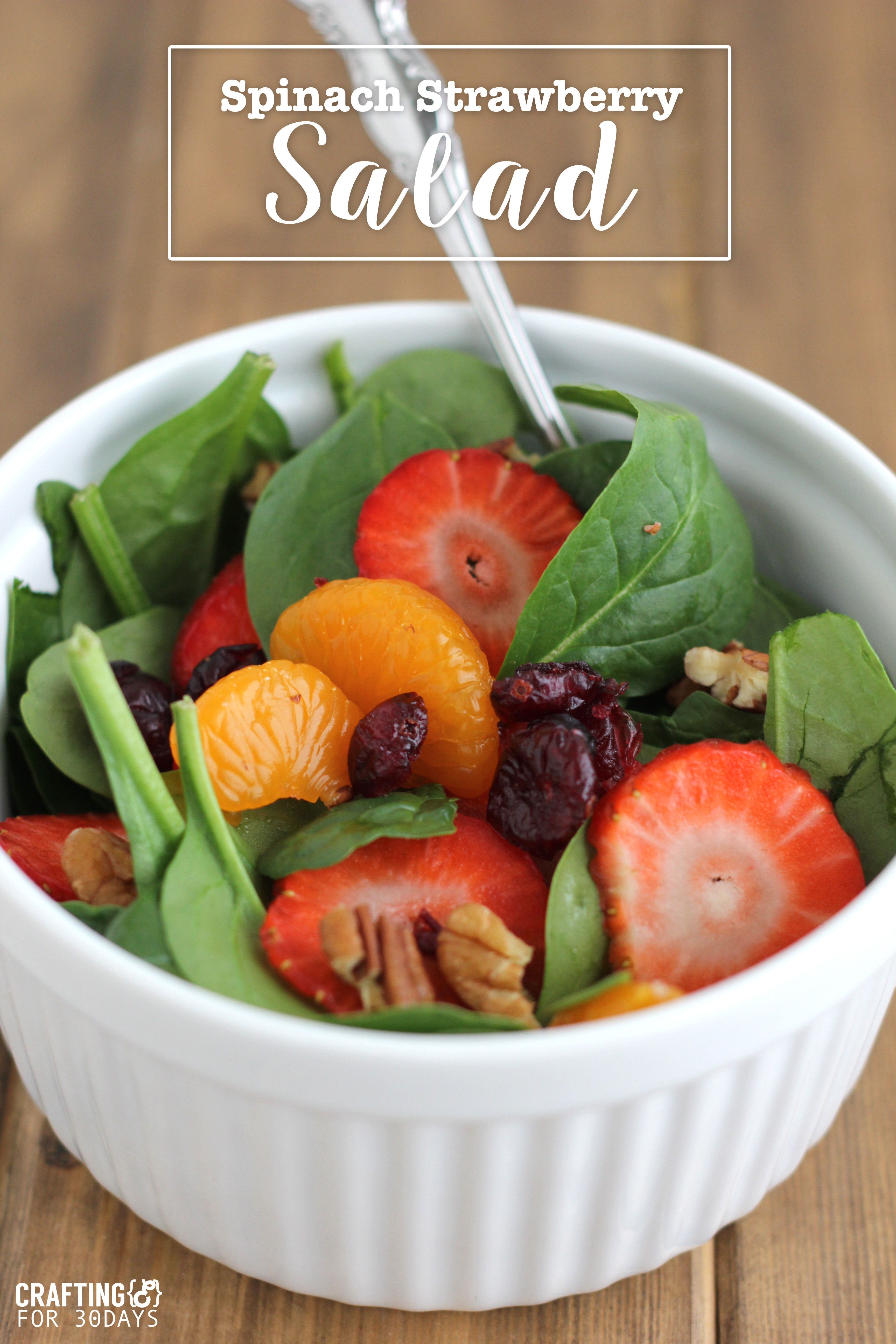 Spinach Strawberry Salad- an awesomely delicious and healthy option for the new year! From CraftingE