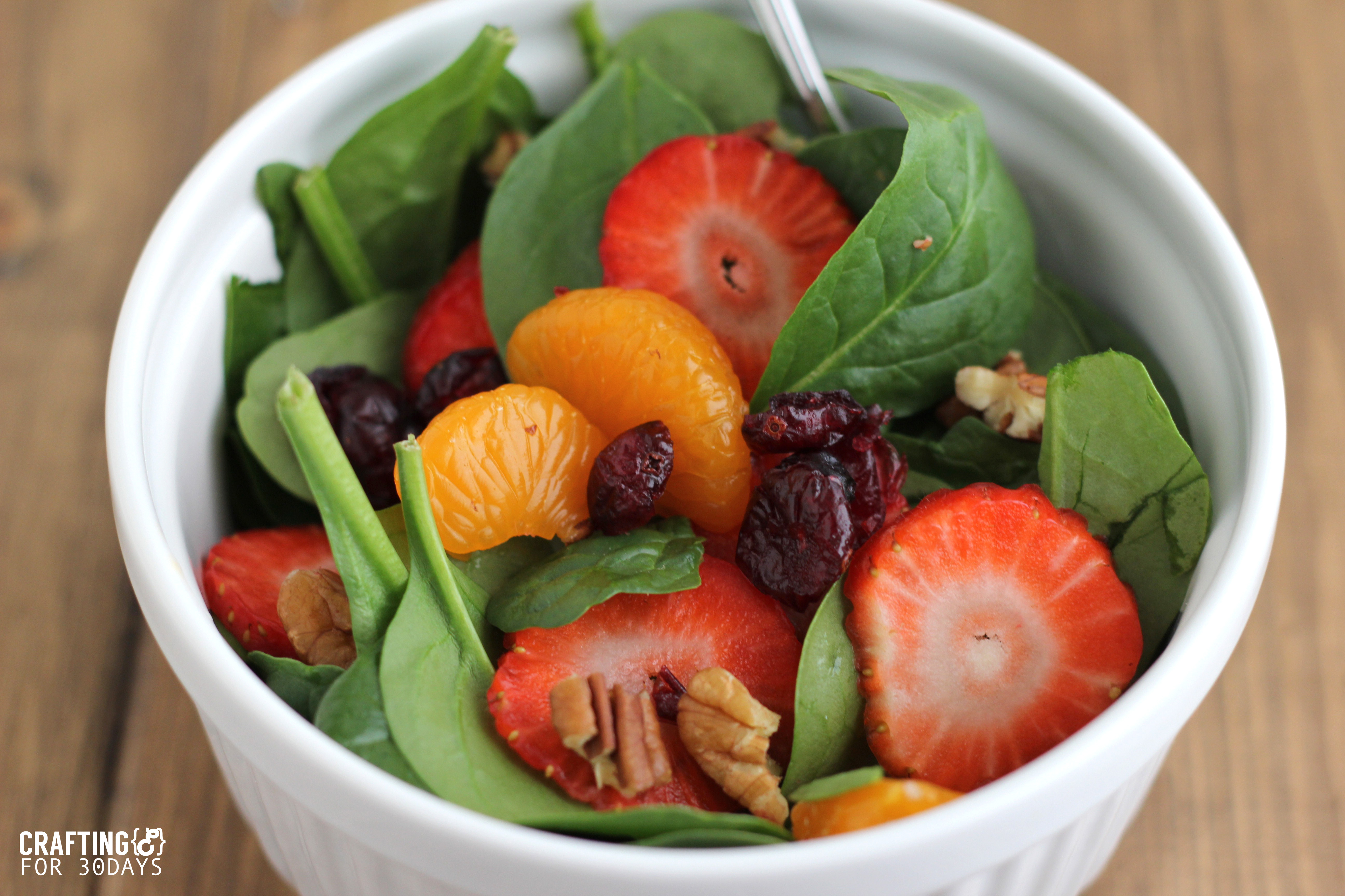 Spinach Strawberry Salad- an awesomely delicious and healthy option for the new year! From CraftingE via www.thirtyhandmadedays.com