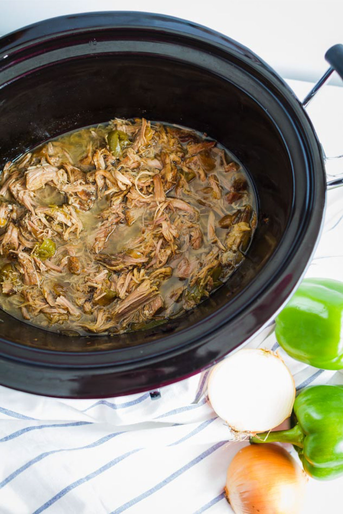 Food: Slow Cooker Pulled Pork - make this super easy dinner recipe and use it in a variety of ways! Step1- putting everything in the crockpot.