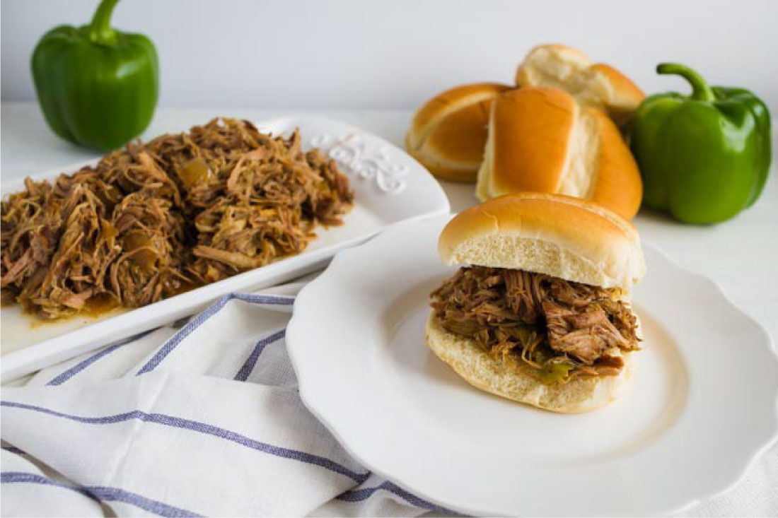 Food: Slow Cooker Pulled Pork - make this super easy dinner recipe and use it in a variety of ways! One of our favorites is on rolls with cream cheese.