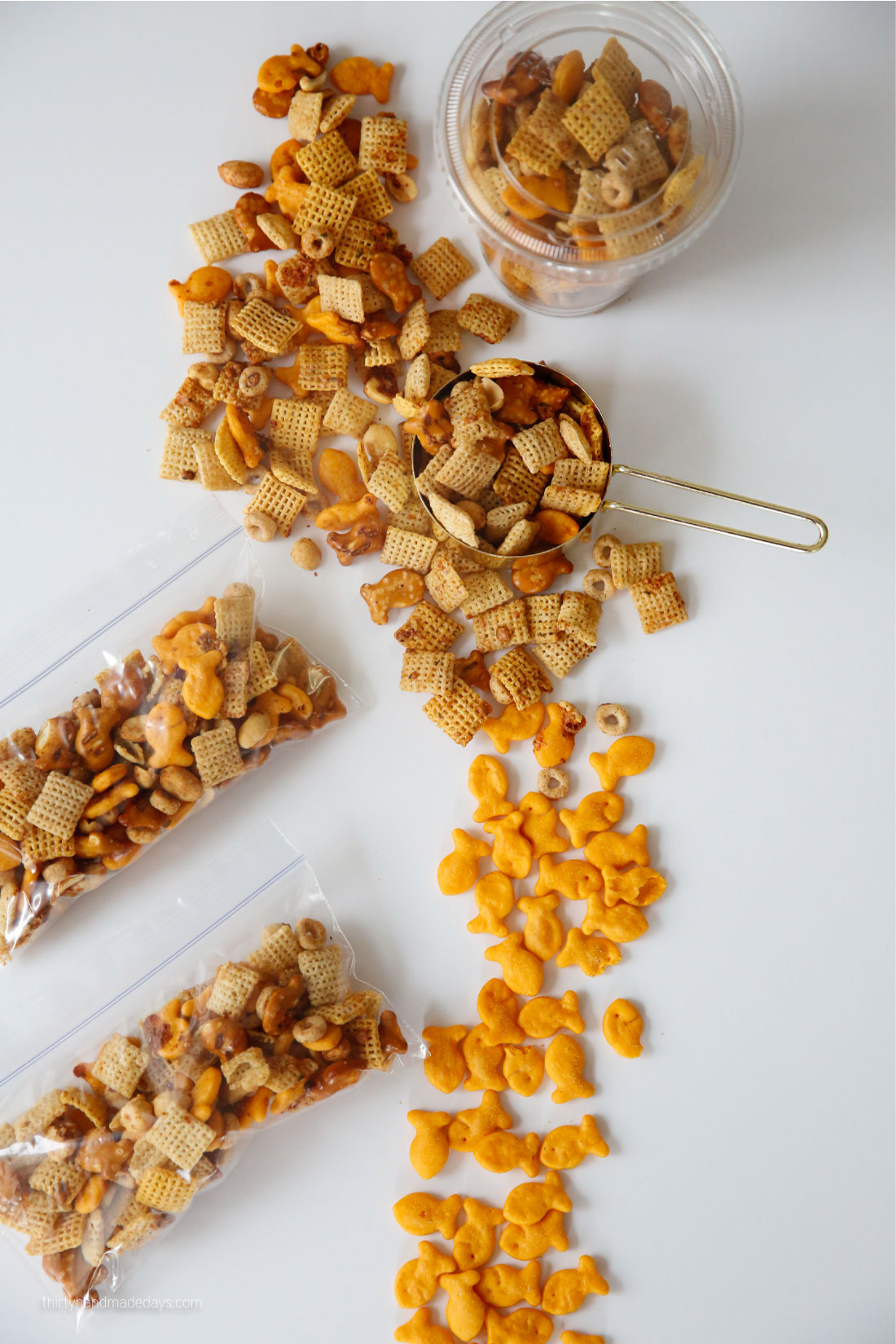 Zesty Ranch Goldfish Mix - combining a few of our favorites for this yummy mix. SO easy the kids can get involved! How to package.