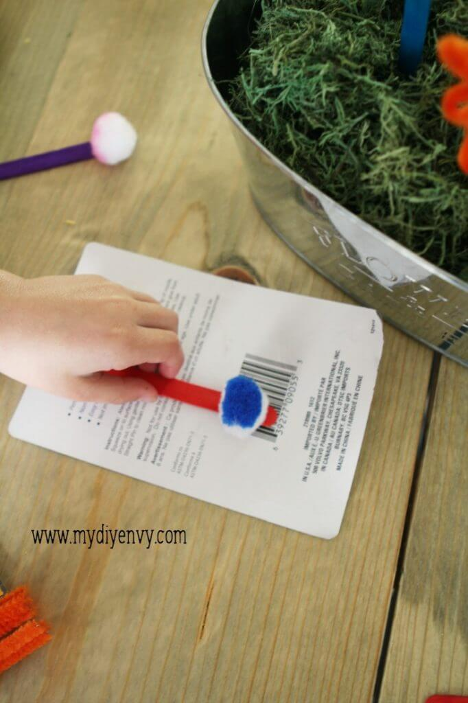 Pipe Cleaner Flowers- a super easy, fun kids activity that is perfect for summer!  Putting together.