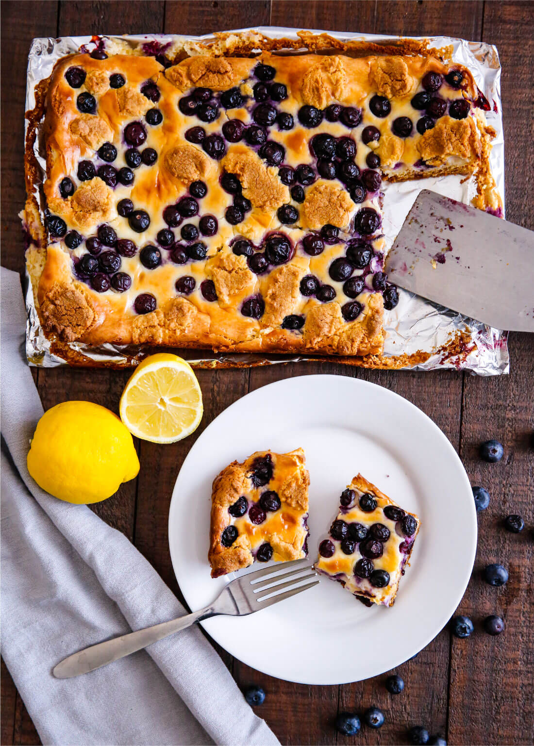 Food: Blueberry Lemon Cheesecake Bars - try this simple and delicious recipe! You'll have a hard time stopping at one piece. from thirtyhandmadedays.com