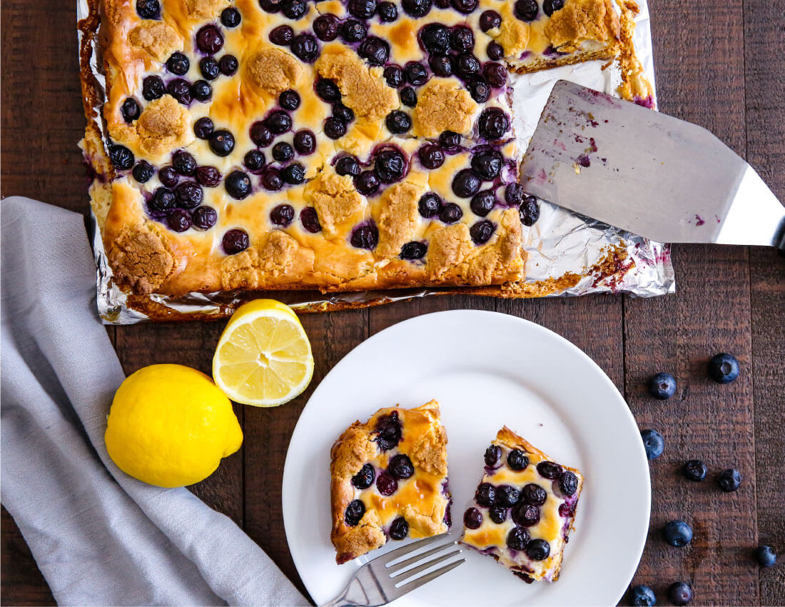 Blueberry Lemon Cheesecake Bars - try this simple and delicious recipe! You'll have a hard time stopping at one piece. from thirtyhandmadedays.com