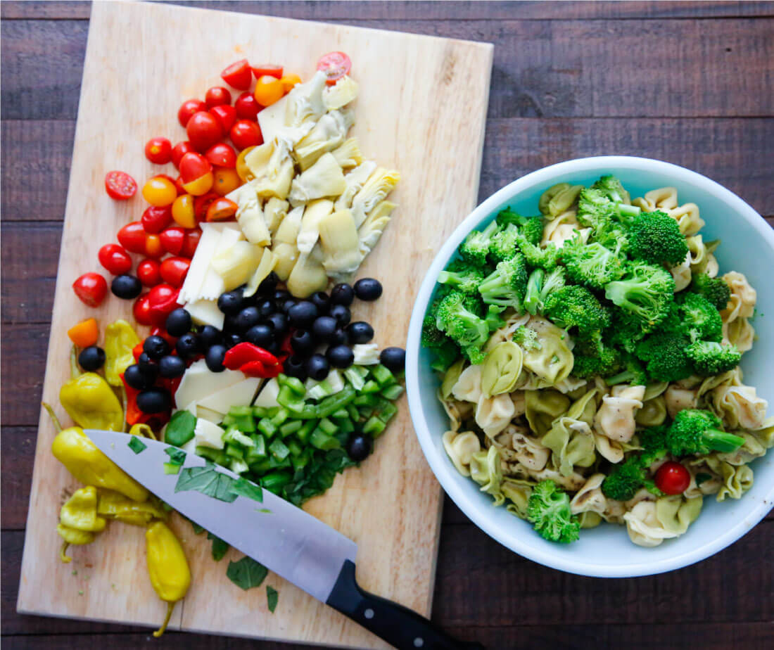 An awesome Italian salad with tortellini, vegetables meats and cheese. This Italian Tortellini Salad will be a huge hit wherever you take it! Perfect potluck dish. Ingredients for the recipe.