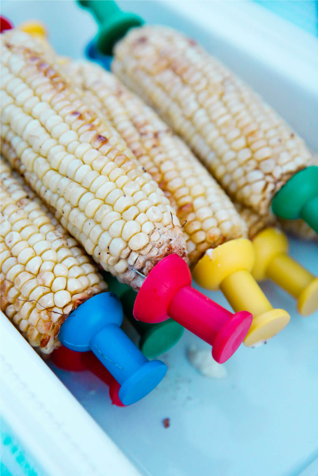 How to make the best corn on the cob - oven baked! www.thirtyhandmadedays.com Served at our outdoor summer party!