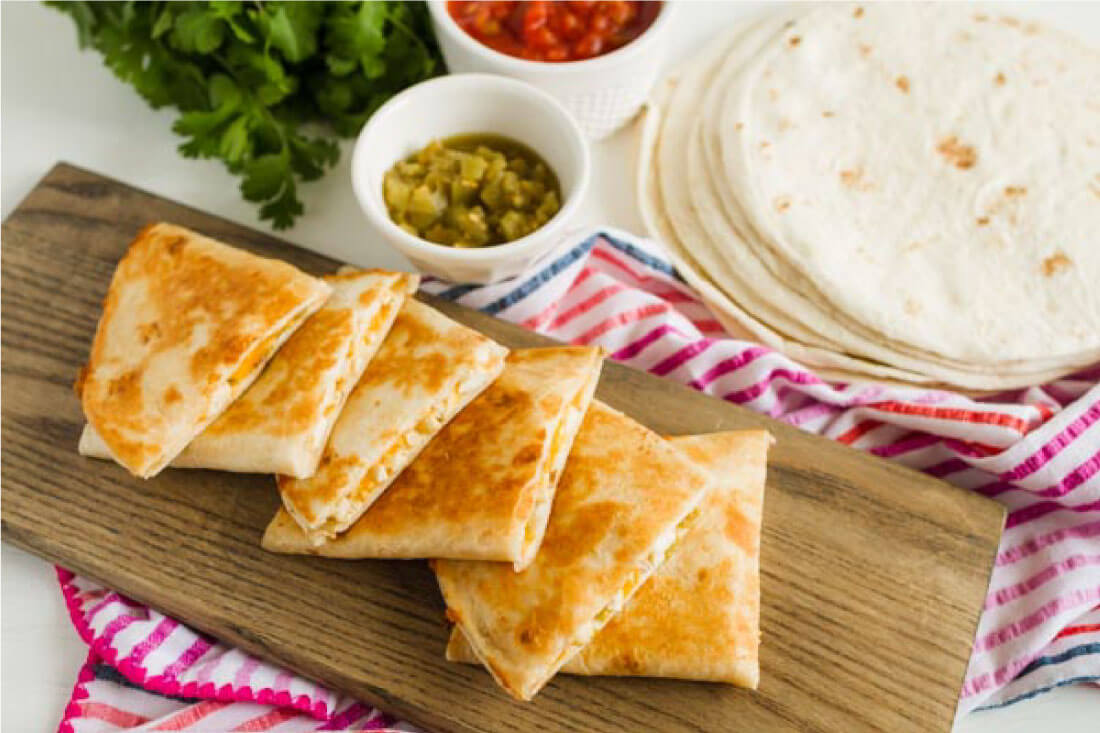 Green Chile Chicken Quesadilla Recipe - an easy to make dinner that the whole family will love. via www.thirtyhandmadedays.com