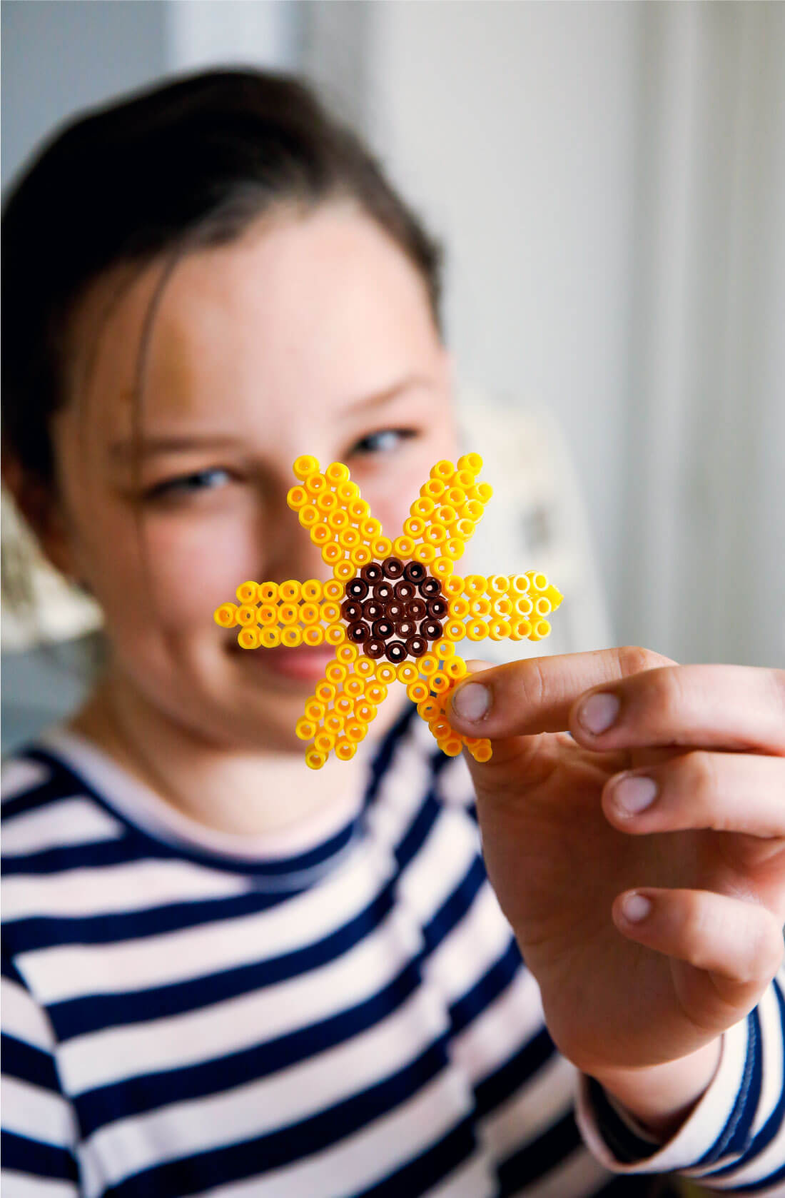 Let's play for change - an awesome Ikea campaign to encourage play. We loved playing with Perler Beads. Julia made a sunflower. www.thirtyhandmadedays.com