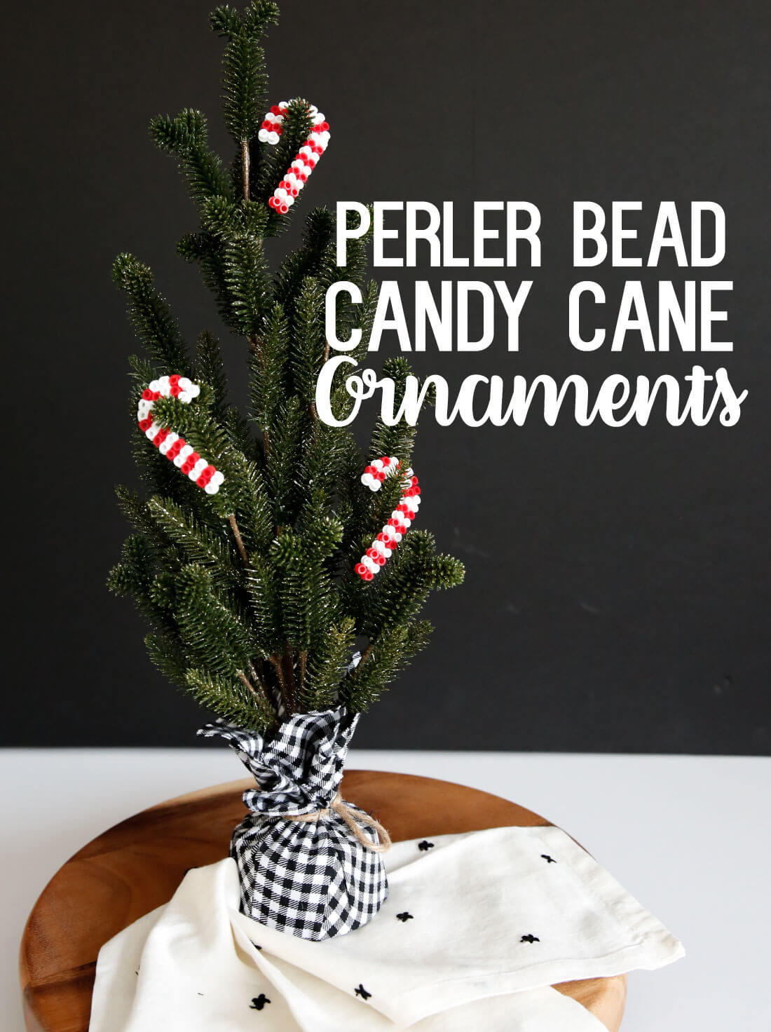 DIY Ornaments made with perler beads. Make these cute candy cane ornaments! www.thirtyhandmadedays.com