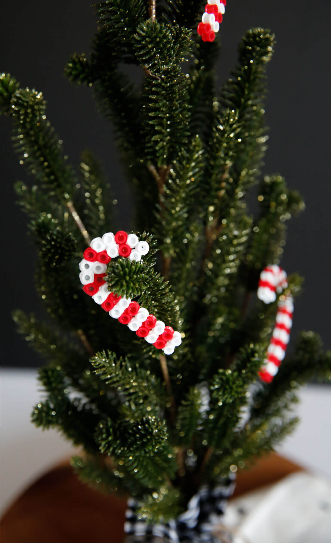 DIY Ornaments made with perler beads. Make these cute candy cane ornaments! These are super easy to make! from www.thirtyhandmadedays.com