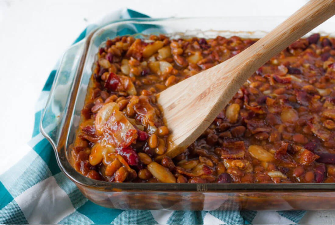 Delicious Baked Beans recipe - perfect for a summer barbecue! Pan with spoon