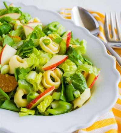 Tortellini Salad - a different take on salad! It has all kind of good ingredients in it. Full bowl of salad.
