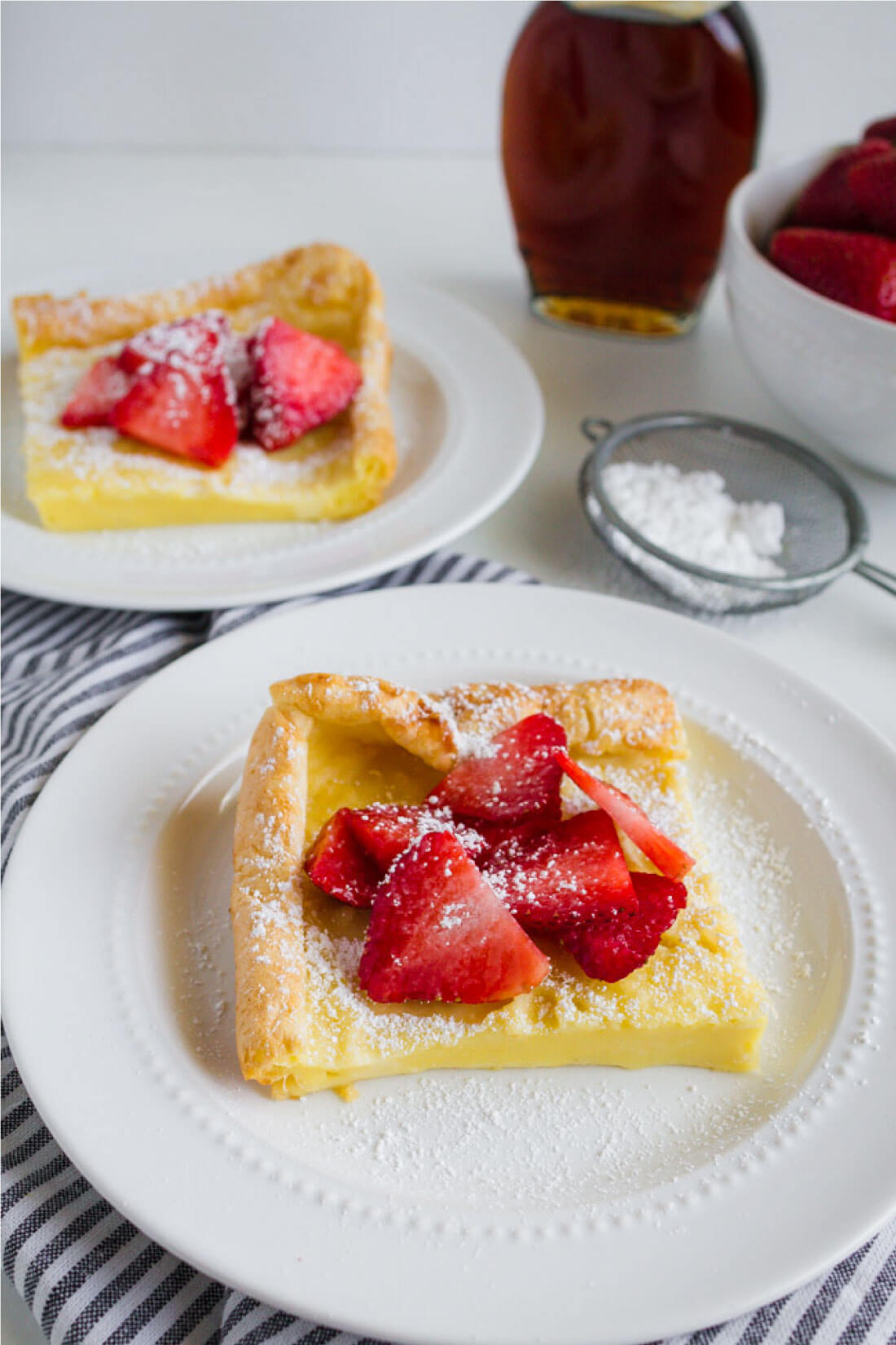German Pancakes or Dutch Baby recipe - an old family favorite that we love to make for breakfast. Cut up.
