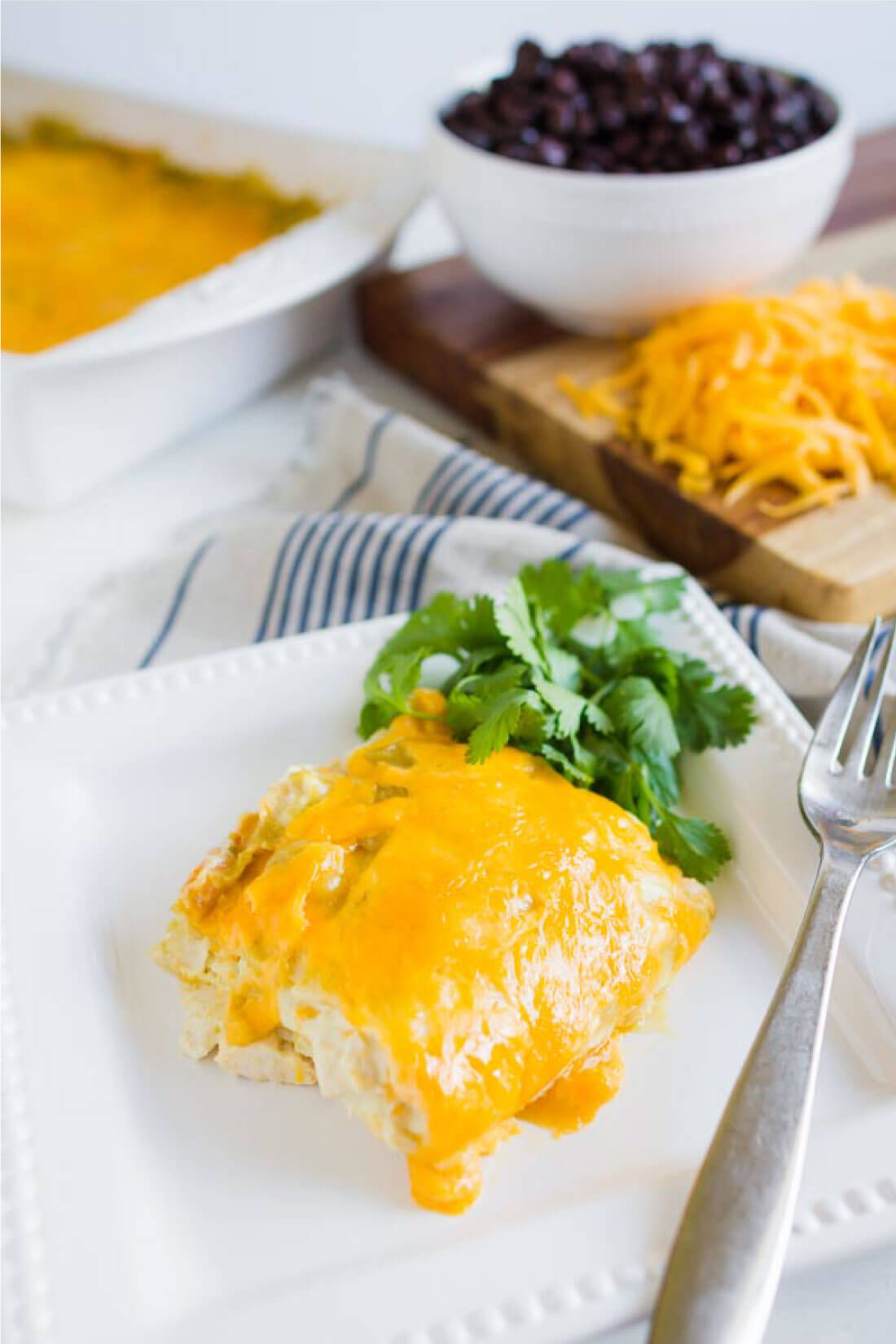 Green Chile Chicken Enchiladas - an easy dinner recipe that your whole family will love! www.thirtyhandmadedays.com