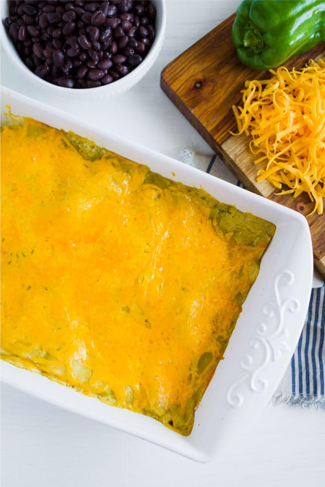 Green Chile Chicken Enchiladas - an easy dinner recipe that your whole family will love! Whole pan