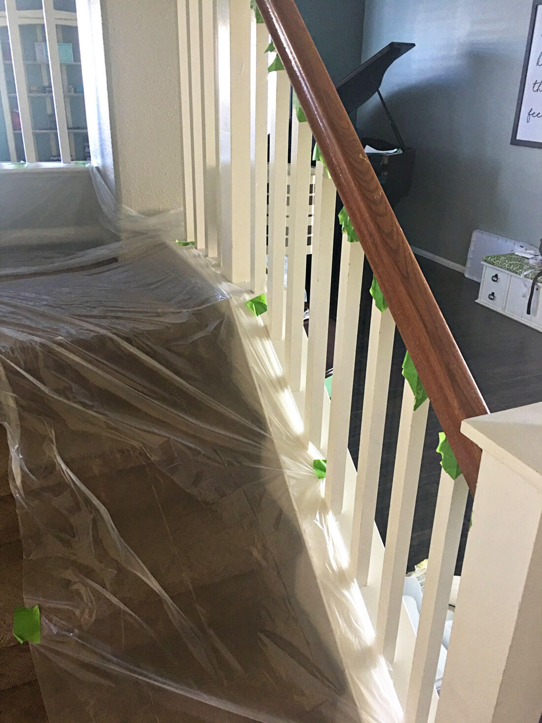 How to paint your stair railings and banister - laying down the dropcloth