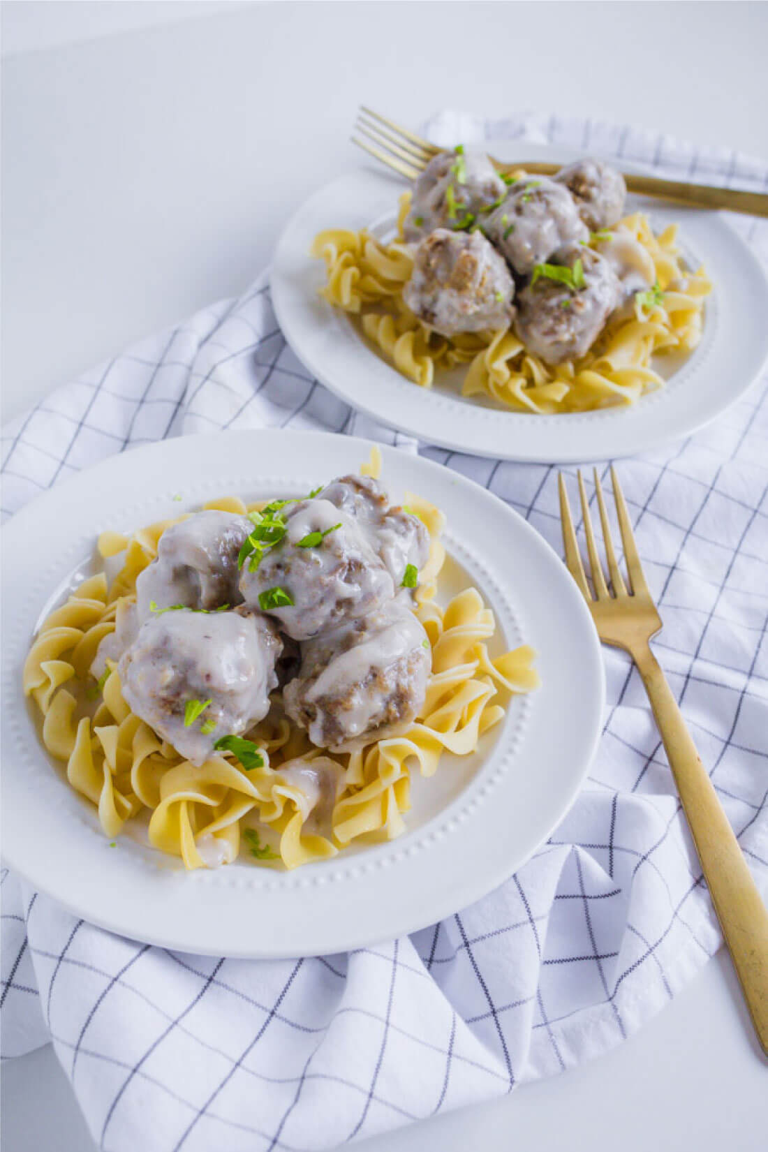 Swedish Meatball Recipe- an easy to make dinner idea with a rich, creamy sauce served over egg noodles.