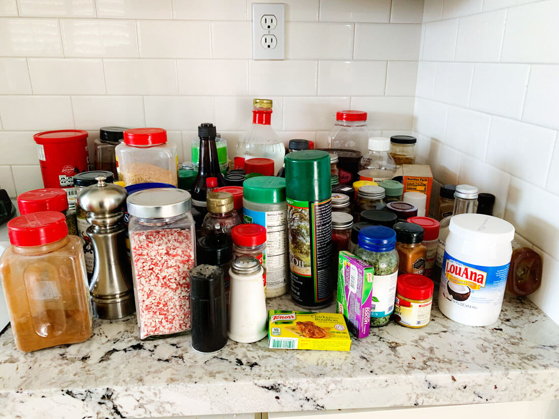 How to organize your spice rack - all of the spices that I pulled out of my cabinets.