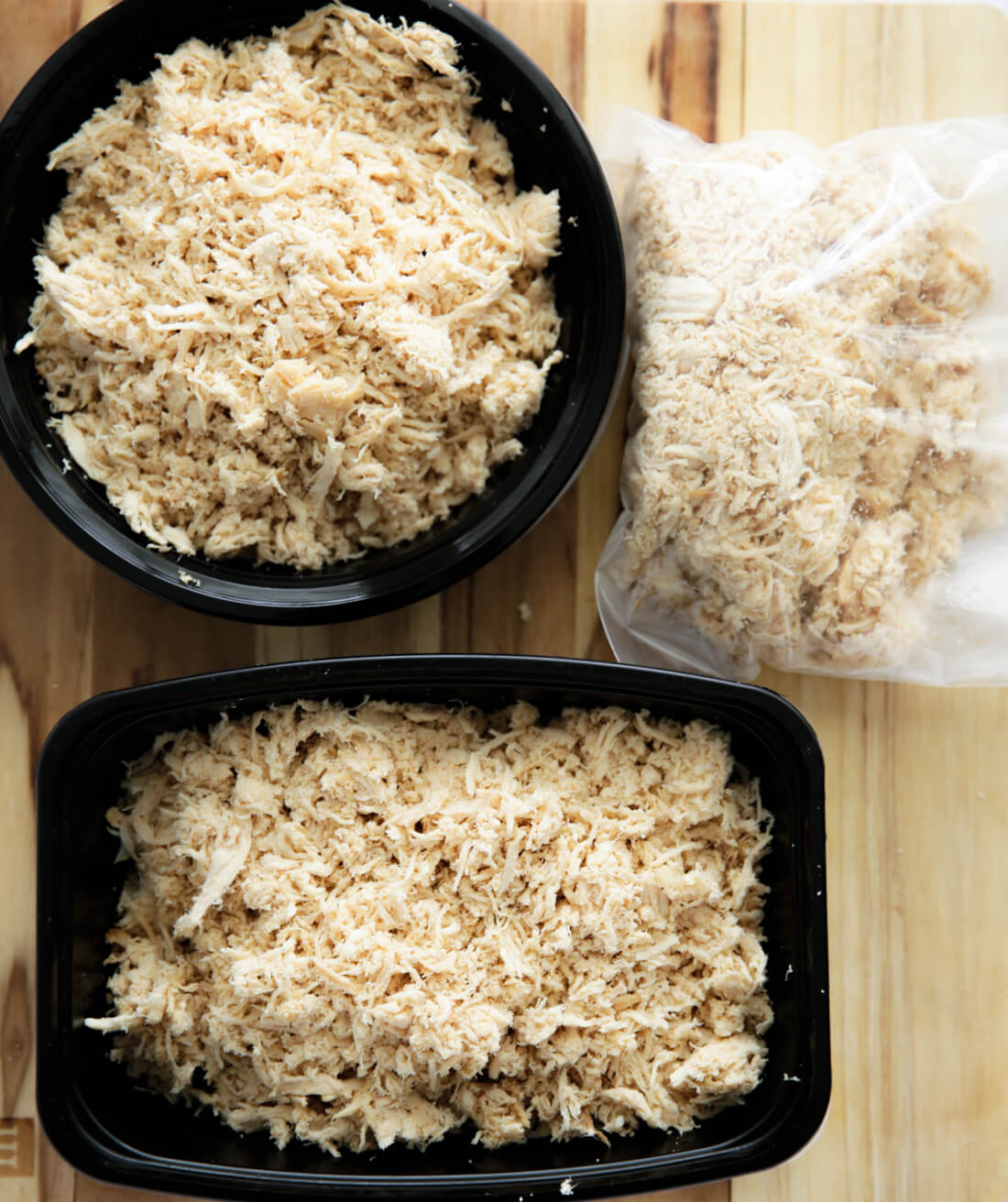 Putting shredded chicken into containers
