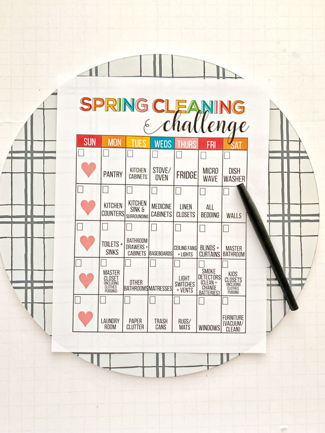 Spring Cleaning List with pen and clipboard