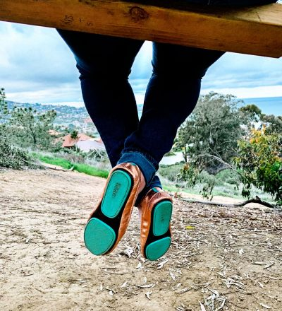 Tieks shoes up close on a swing