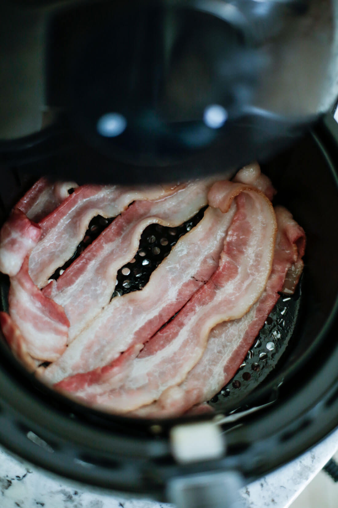 Half way through cooking air fryer bacon